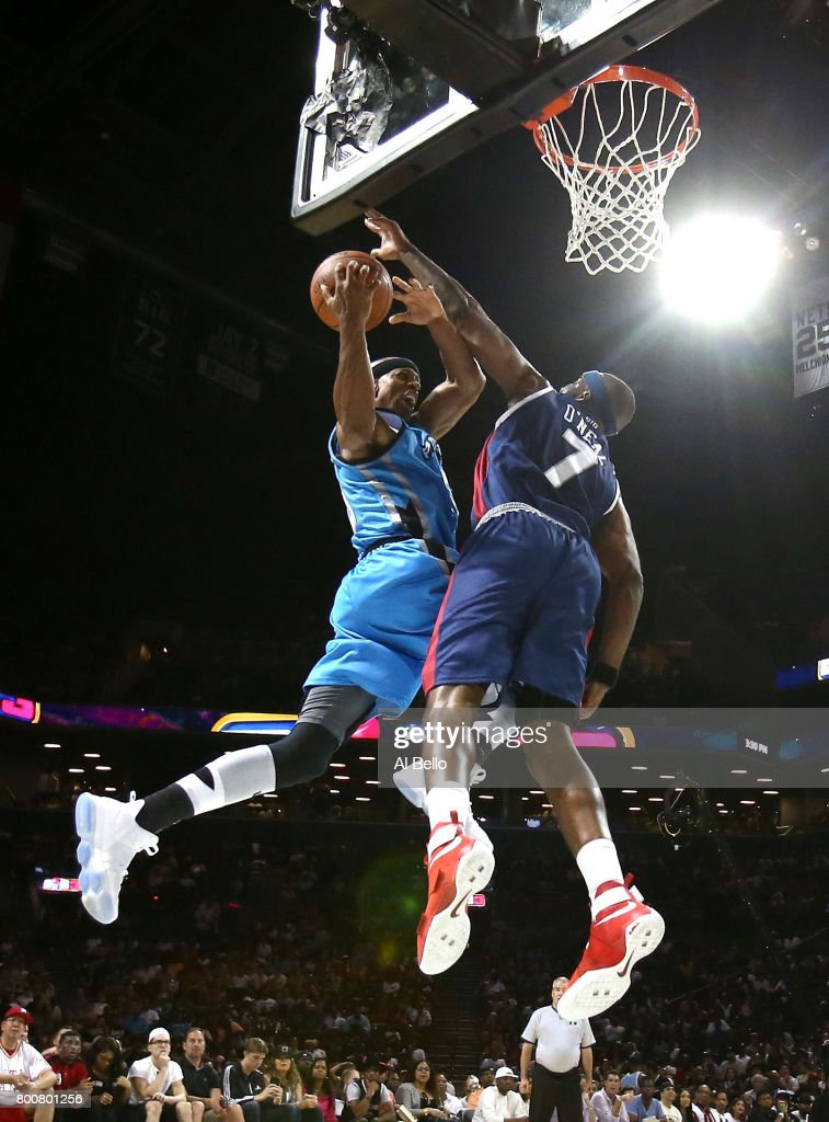 Jerome Williams #13 of Power drives to the basket against Jermaine O'Neal #7 of Tri-State during week one of the BIG3 three on three basketball league at Barclays Center on June 25, 2017 in New York City.