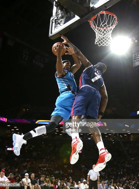 Jerome Williams of Power drives to the basket against Jermaine O'Neal of TriState during week one of the BIG3 three on three basketball league at...