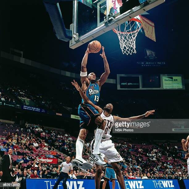 Jerome Williams of the Detroit Pistons shoots against the New Jersey Nets during a game played circa 2001 at Continental Airlines Arena in East...