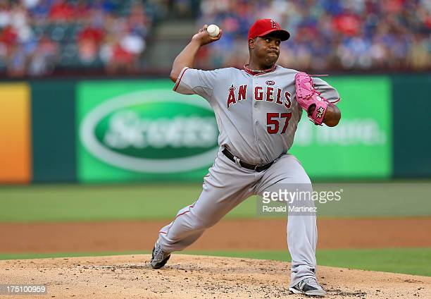 Jerome Williams of the Los Angeles Angels throws against the Texas Rangers at Rangers Ballpark in Arlington on July 31 2013 in Arlington Texas