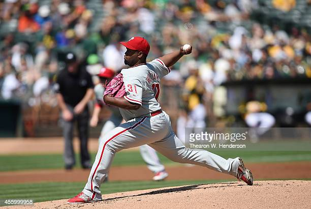 Jerome Williams of the Philadelphia Phillies pitches against the Oakland Athletics in the bottom of the first inning at Oco Coliseum on September 20...