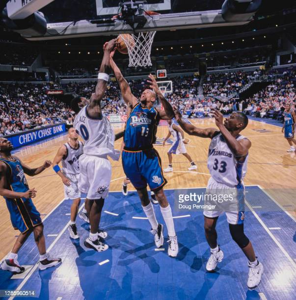 Jerome Williams, Power Forward for the Detroit Pistons and Rasheed Wallace, Center for the Washington Wizards challenge for the ball during their NBA...