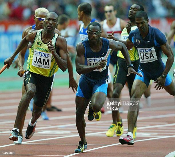Jerome Young of the USA and Michael Blackwood of Jamaica finish the last leg of the men's 4 x 400m relay final at the 9th IAAF World Athletics...