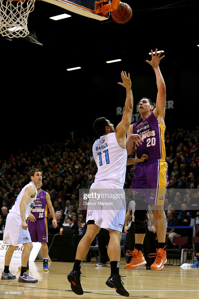 Jeromie Hill of the Sydney Kings(R) takes a shot while guarded by Duane Bailey of the New Zealand Breakers during the NBL pre-season match between the New Zealand Breakers and the Sydney Kings at Stadium Southland on September 11, 2015 in Invercargill, New Zealand.