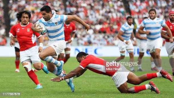 Jeronimo De La Fuente of Argentina runs past David Halaifonua of Tonga during the Rugby World Cup 2019 Group C game between Argentina and Tonga at...