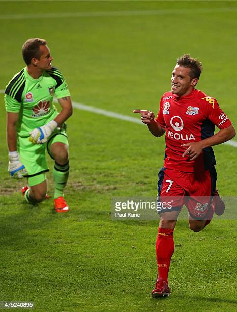 Jeronimo Neumann of Adelaide celebrates a goal as Glenn Moss of the Phoenix looks on during the round 21 ALeague match between Adelaide United and...