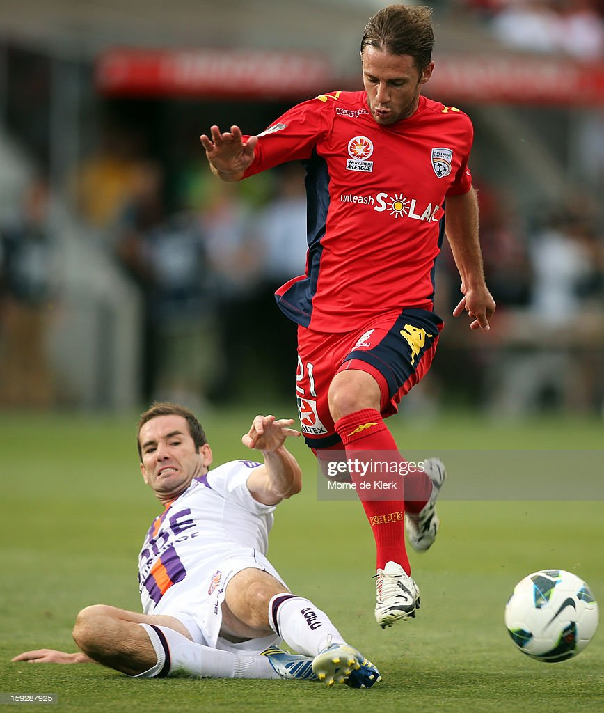 Jeronimo Neumann of Adelaide gets away from Dean Heffernan of Perth during the round 16 A-League match between Adelaide United and the Perth Glory at Hindmarsh Stadium on January 11, 2013 in Adelaide, Australia.