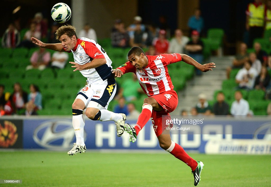 Jeronimo Neumann of United (L) and Patrick Gerhardt of the Heart contest for the ball during the round seventeen A-League match between Melbourne Heart and Adelaide United at AAMI Park on January 18, 2013 in Melbourne, Australia.