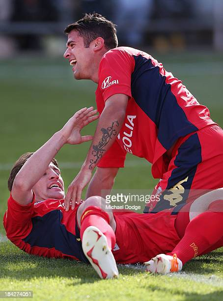 Jeronimo Neumann of United celebrates a goal with Fabio Ferriera during the round one ALeague match between Perth Glory and Adelaide United at...