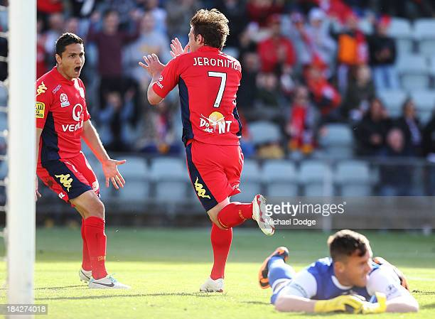 Jeronimo Neumann of United celebrates a goal with Marcello Carrusca during the round one ALeague match between Perth Glory and Adelaide United at...