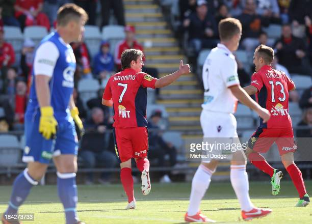 Jeronimo Neumann of United celebrates a goal with Steven Lustica during the round one ALeague match between Perth Glory and Adelaide United at...