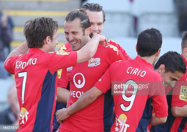 Jeronimo Neumann of United celebrates a goal with teamates during the round one ALeague match between Perth Glory and Adelaide United at Coopers...
