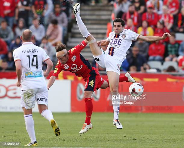 Jeronimo Neumann of United contests for the ball against Steve Pantelidis of the Glory during the round one ALeague match between Perth Glory and...