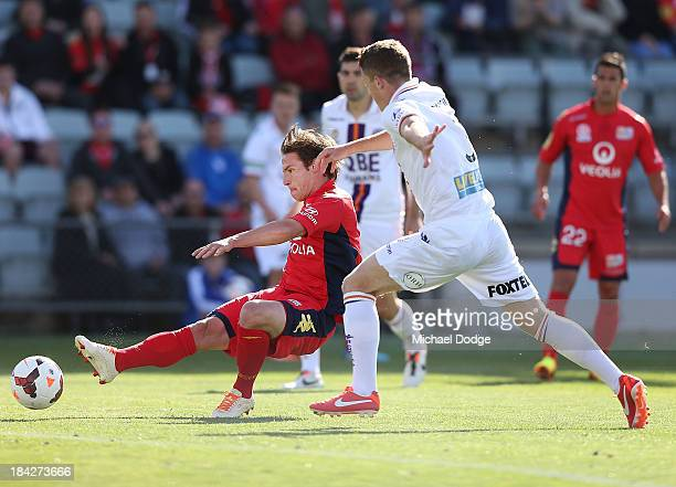 Jeronimo Neumann of United kicks the ball for a goal during the round one ALeague match between Perth Glory and Adelaide United at Coopers Stadium on...