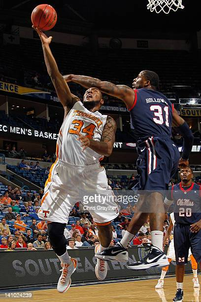 Jeronne Maymon of the Tennessee Volunteers shoots the ball over Murphy Holloway of the Mississippi Rebels during the quarterfinals of the SEC Men's...
