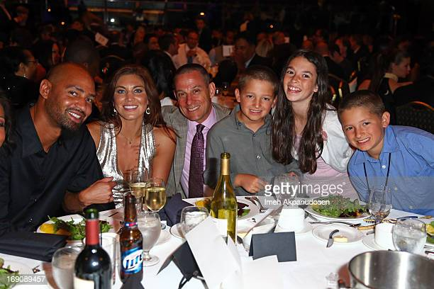 Jerramy Stevens, honoree Hope Solo, and guests attend the 28th Anniversary Sports Spectacular Gala at the Hyatt Regency Century Plaza on May 19, 2013...