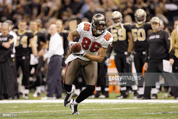 Jerramy Stevens of the Tampa Bay Buccaneers carries the ball during the game against the New Orleans Saints at the Louisiana Superdome on December 27...