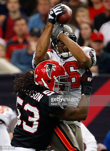 Jerramy Stevens of the Tampa Bay Buccaneers pulls in this reception against Mike Peterson of the Atlanta Falcons at Georgia Dome on November 29 2009...