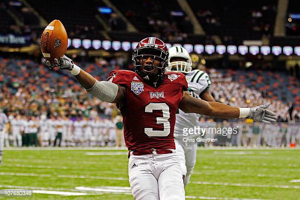 Jerrel Jernigan of the Troy University Trojans scores a touchdown over Donovan Fletcher of the Ohio University Bobcats during the RL Carriers New...