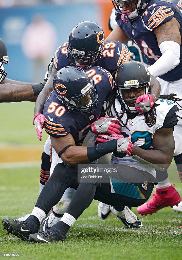 Jerrell Freeman #50 and Harold Jones-Quartey #26 of the Chicago Bears make a tackle against Chris Ivory #33 of the Jacksonville Jaguars in the third quarter of the game at Soldier Field on October 16, 2016 in Chicago, Illinois. The Jaguars defeated the Bears 17-16.