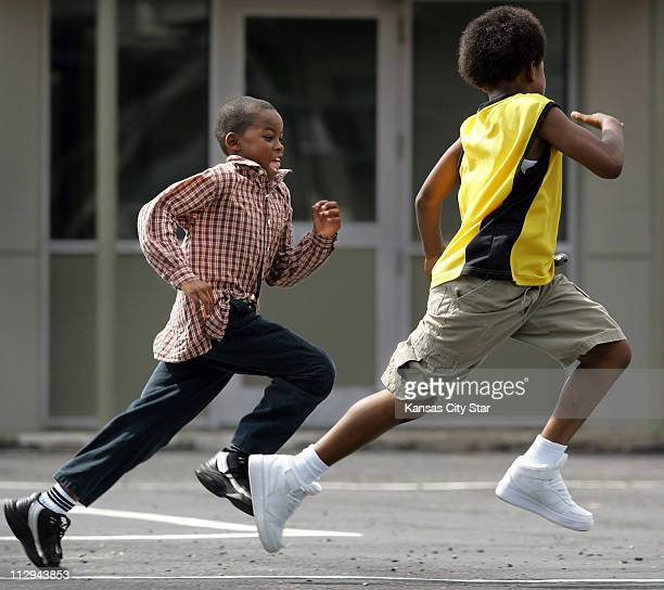 Jerrian Wilson left chases down Jeromie Simmons during a game of Dog Pound during recess at Anthony Elementary School August 17 in Leavenworth Kansas