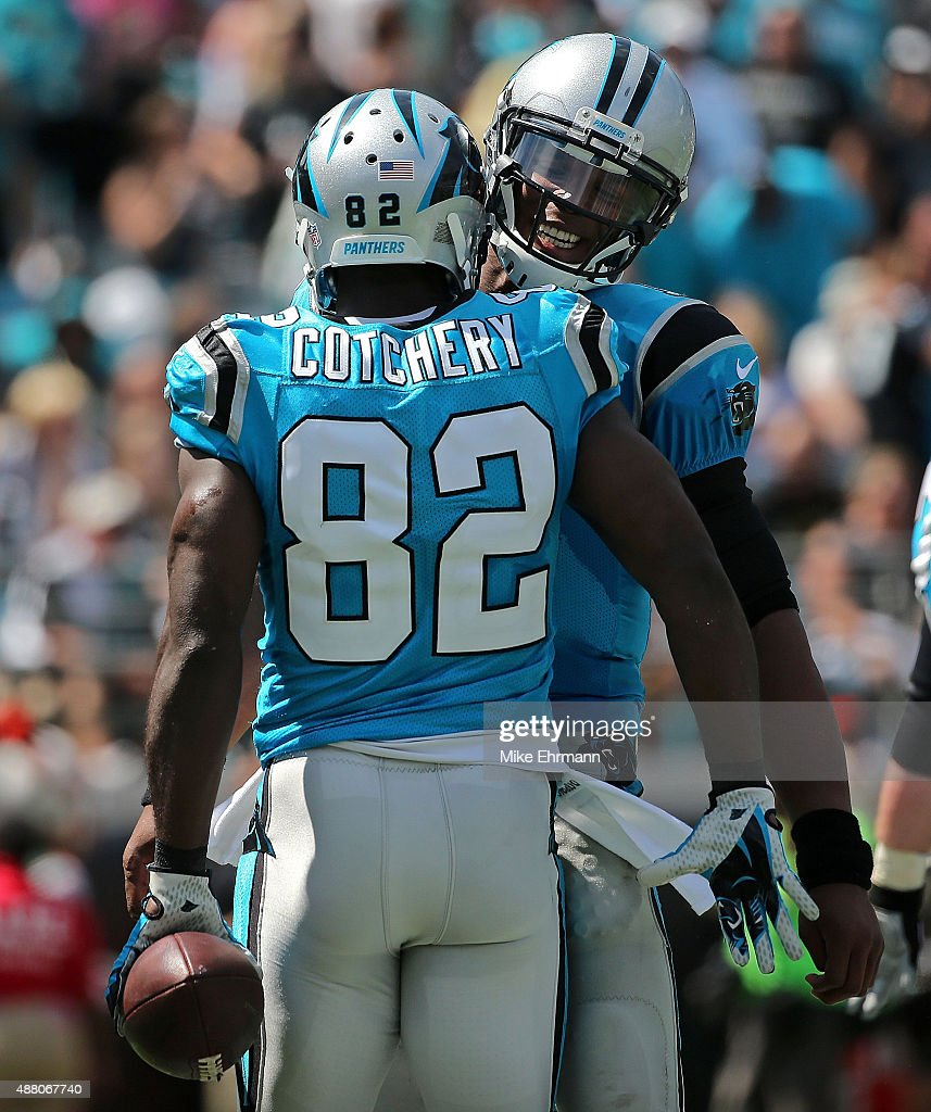 Jerricho Cotchery #82 and Cam Newton #1 of the Carolina Panthers celebrates a touchdown during a game against the Jacksonville Jaguars at EverBank Field on September 13, 2015 in Jacksonville, Florida.