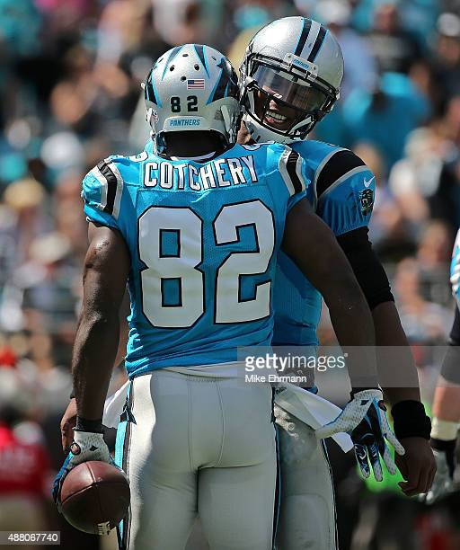 Jerricho Cotchery and Cam Newton of the Carolina Panthers celebrates a touchdown during a game against the Jacksonville Jaguars at EverBank Field on...