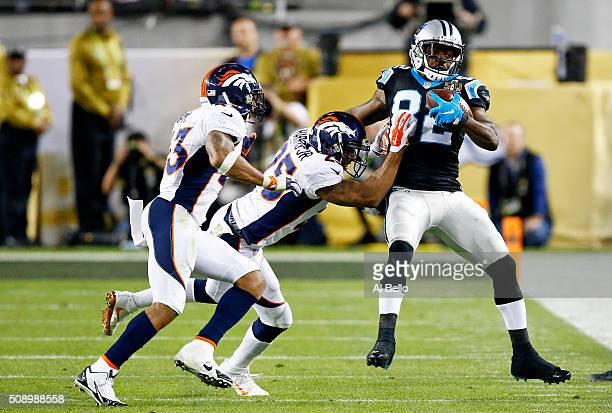 Jerricho Cotchery of the Carolina Panthers makes a catch against Chris Harris of the Denver Broncos during Super Bowl 50 at Levi's Stadium on...