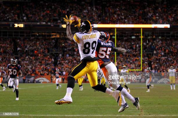 Jerricho Cotchery of the Pittsburgh Steelers catches a touchdown pass to tie the game in fourth quarter against DJ Williams of the Denver Broncos...