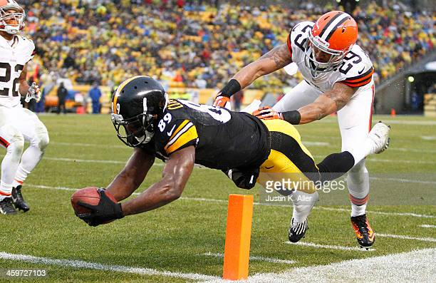 Jerricho Cotchery of the Pittsburgh Steelers dives for the pylon scoring a nine yard touchdown against Leon McFadden of the Cleveland Browns during...