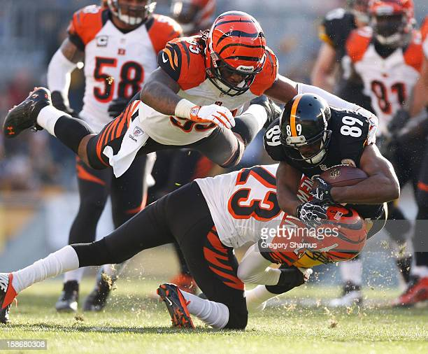 Jerricho Cotchery of the Pittsburgh Steelers is tackled by Terence Newman and Vontaze Burfict of the Cincinnati Bengals after a second quarter catch...