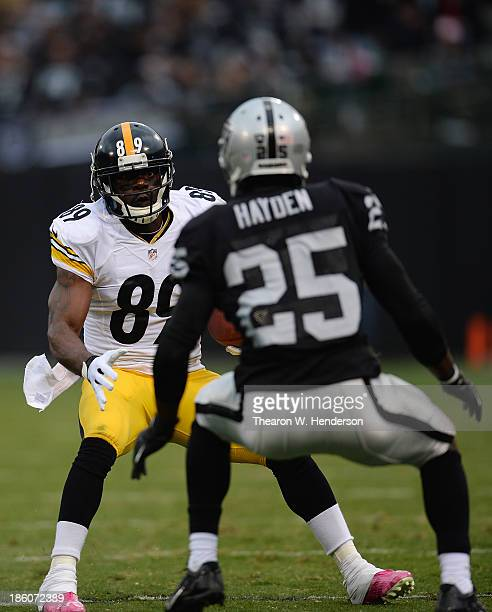 Jerricho Cotchery of the Pittsburgh Steelers looks to put a move on DJ Hayden of the Oakland Raiders during the fourth quarter at O.co Coliseum on...