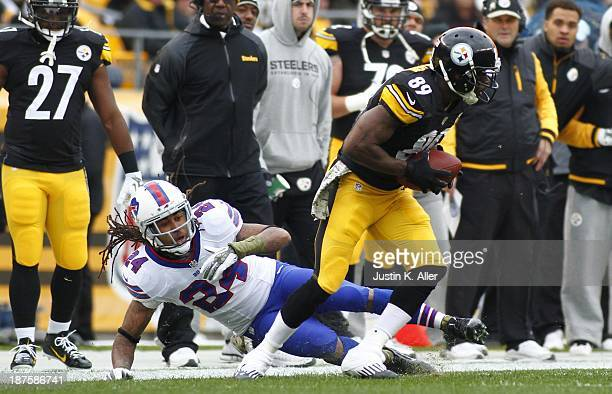 Jerricho Cotchery of the Pittsburgh Steelers spins away from Stephon Gilmore of the Buffalo Bills during the game on November 10 2013 at Heinz Field...