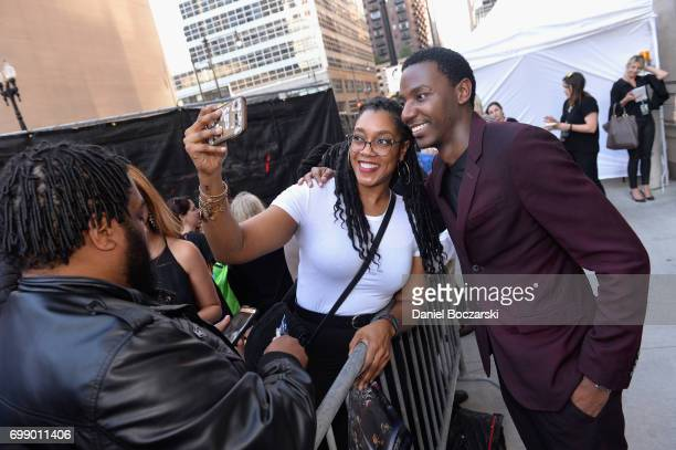 Jerrod Carmichael signs autographs at the US premiere of 'Transformers The Last Knight' at the Civic Opera House on June 20 2017 in Chicago Illinois