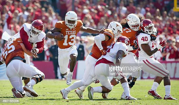 Jerrod Heard of the Texas Longhorns carries the ball against the Oklahoma Sooners in the second quarter during the ATT Red River Showdown at the...