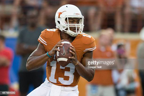Jerrod Heard of the Texas Longhorns drops back to pass against the Rice Owls during the first quarter on September 12 2015 at Darrell K RoyalTexas...