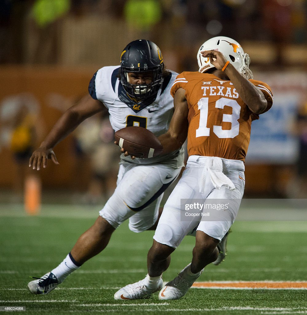 Jerrod Heard #13 of the Texas Longhorns is brought down by his facemask by James Looney #9 of the California Golden Bears during the third quarter on September 19, 2015 at Darrell K Royal-Texas Memorial Stadium in Austin, Texas.