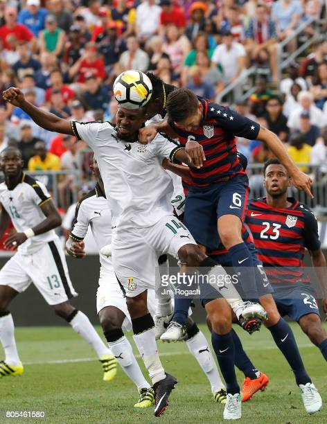 Jerry Akaminko of Ghana heads the ball toward the net as Kelyn Rowe of the United States defends in the second half during an international friendly...