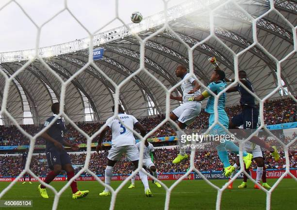 Jerry Bengtson and goalkeeper Noel Valladares of Honduras jump with Paul Pogba of France during the 2014 FIFA World Cup Brazil Group E match between...