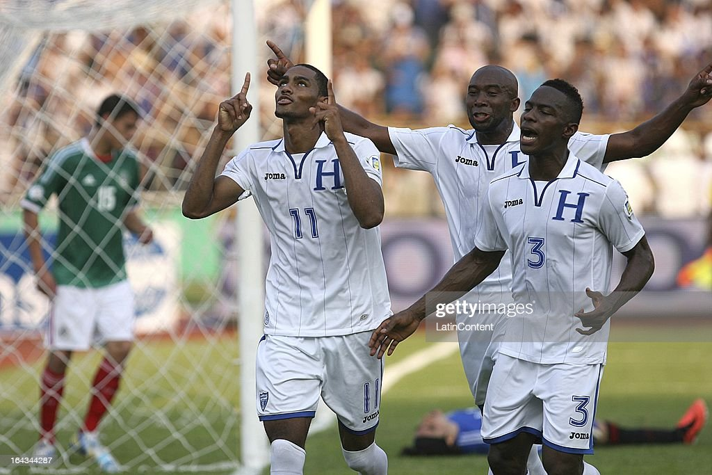 Jerry Bengtson and Maynor Figueroa of Honduras celebrates a goal during a match between Mexico and Honduras as part of the Concacaf Qualifiers at Olimpico de San Pedro Sula stadium on March 22, 2013 in San Pedro Sula, Honduras.