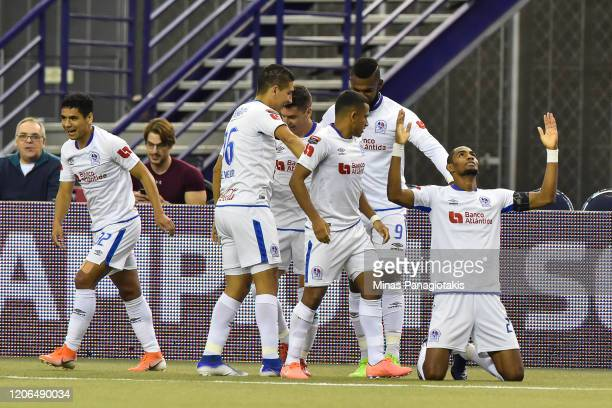 Jerry Bengtson of CD Olimpia celebrates a goal with teammates in the first half during the 1st leg of the CONCACAF Champions League quarterfinal game...