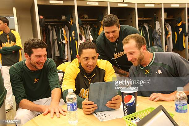 Jerry Blevins Brian Fuentes Travis Blackley and Dallas Braden of the Oakland Athletics watch youtube videos in the clubhouse prior to the game...