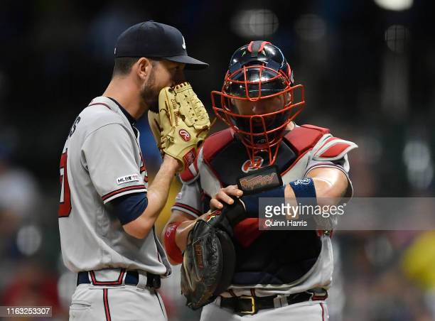 Jerry Blevins of the Atlanta Braves discusses with Tyler Flowers of the Atlanta Braves against the Milwaukee Brewers at Miller Park on July 16 2019...