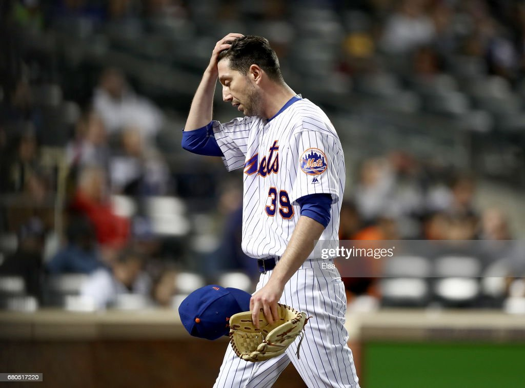 Jerry Blevins #39 of the New York Mets walks back to the dugout after the seventh inning against the San Francisco Giants on May 8, 2017 at Citi Field in the Flushing neighborhood of the Queens borough of New York City.