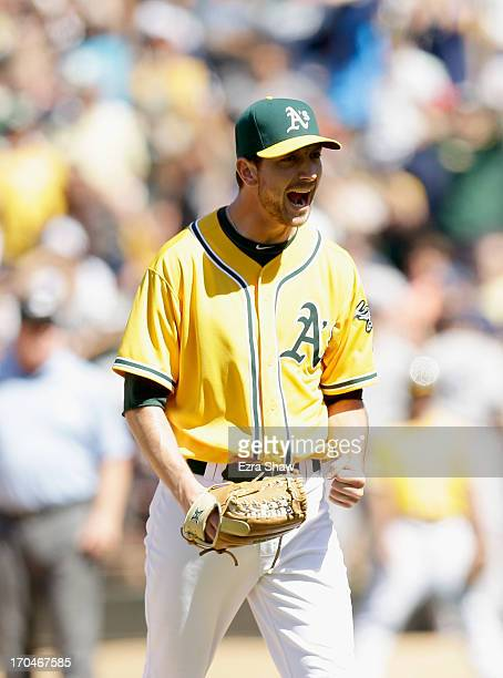 Jerry Blevins of the Oakland Athletics reacts after he struck out Kevin Youkilis of the New York Yankees with the bases loaded to end the top of the...
