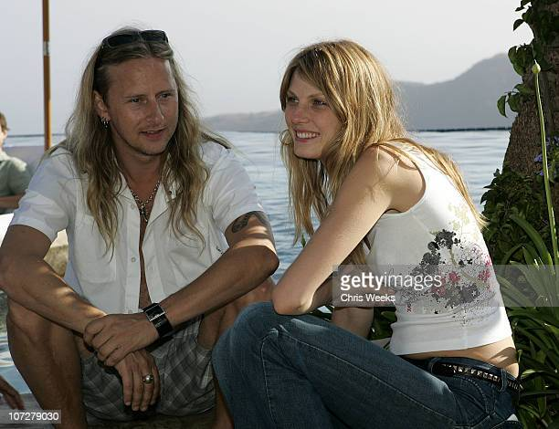 Jerry Cantrell and Angela Lindvall during No Ten by Tanqueray hosts Angela Lindvall's Pool Party Benefitting The Collage Foundation at Private...