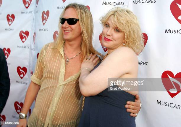 Jerry Cantrell and Courtney Love during Musicares MAP Fund Benefit Concert to Honor Dave Navarro at The Music Box in Hollywood California United...