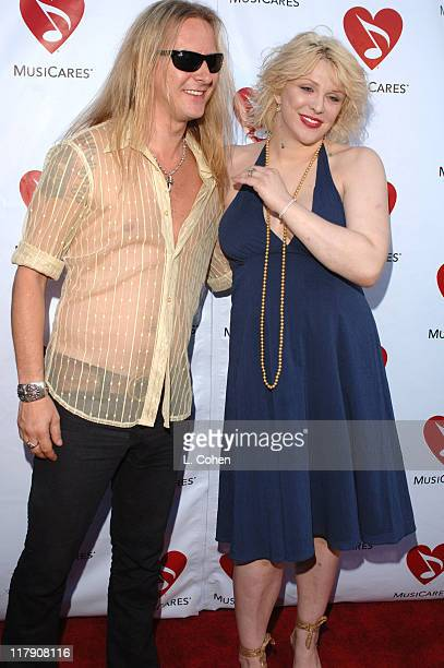Jerry Cantrell and Courtney Love during Musicares MAP Fund Benefit Concert Red Carpet at The Music Box in Los Angeles California United States