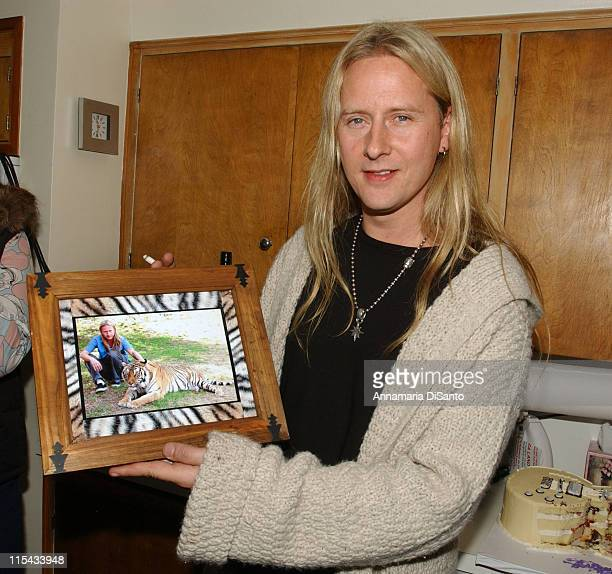 Jerry Cantrell of Alice in Chains with photo of him at an animal wildlife sanctuary