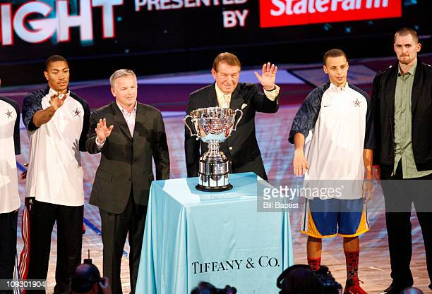 Jerry Colangelo presents a trophy to Derrick Rose of the Chicago Bulls Stephen Curry of the Golden State Warriors and Kevin Love of the Minnesota...